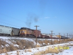 UP 5611 pushes on freight after eastbound (<) takes to siding and clears mainline