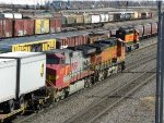 BNSF 5350 West about to pass BNSF SD40 - 2 #1716 (new Switch Locomotive at Northtown Yard)