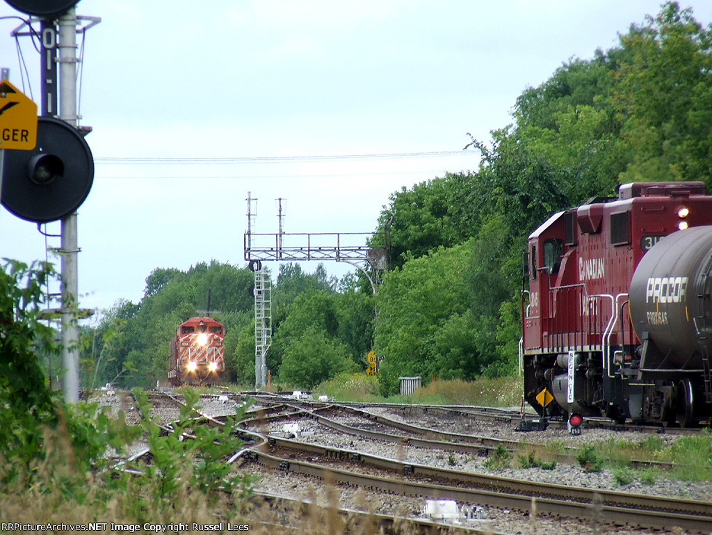 CP 3105 west leaves while CP 9014 south waits to enter