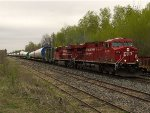 CP train 785 - windmill tower mid sections - at Bedell crossover