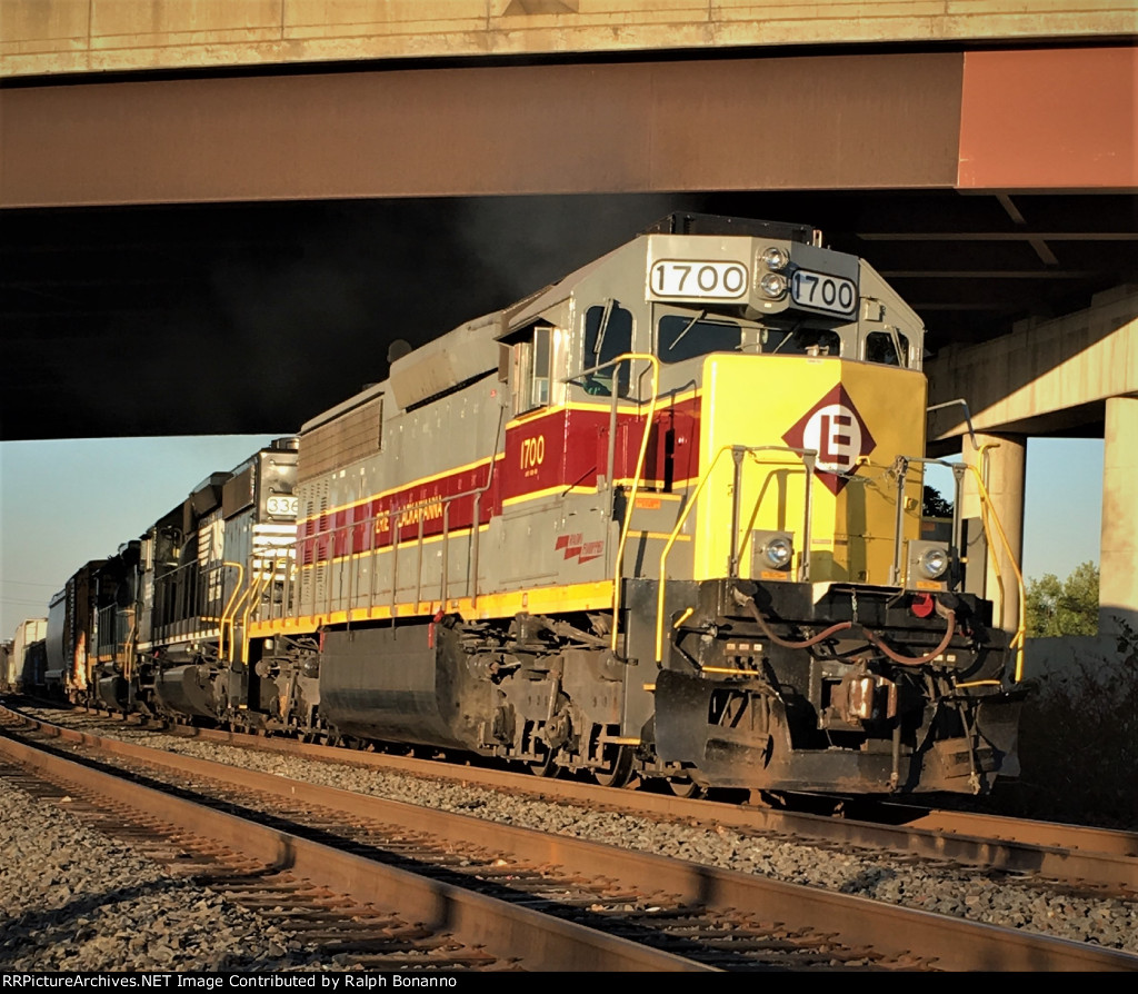 Shared Assets local southbound in the afternoon sun led by Heritage SD45-2 1700
