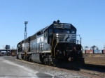 A apir of SD45-2's sit in the afternoon sun at Oak Island yard