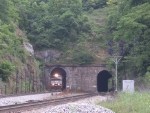 WB coal train pops out of the tunnel