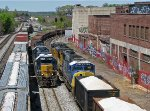 CSX 2512 leading side dump train W097 through the alley of trains at Howell