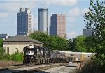 NS 5575 leading P76 by King Plow with the Atlanta Skyline