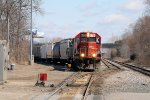A couple SOO GP38's move cars into a siding