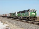 Rare units out of storage BN SD60M 8184 on the point of a EB grain train just outside Rochelle Ill. 3.11