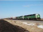 Trio of BN SD60M's on grain train just east of Rochelle Ill 3.11