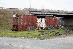 A boxcar awaits its fate after the CSX Derailment at CP 128