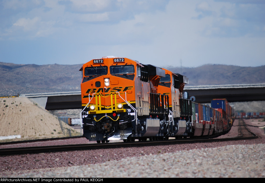 BNSF 6672 and BNSF 6673 on thier First Revenue Run westbound lead the Z CHI-SCO Intermodal Train with the Hwy 58 Bridge in the Background.