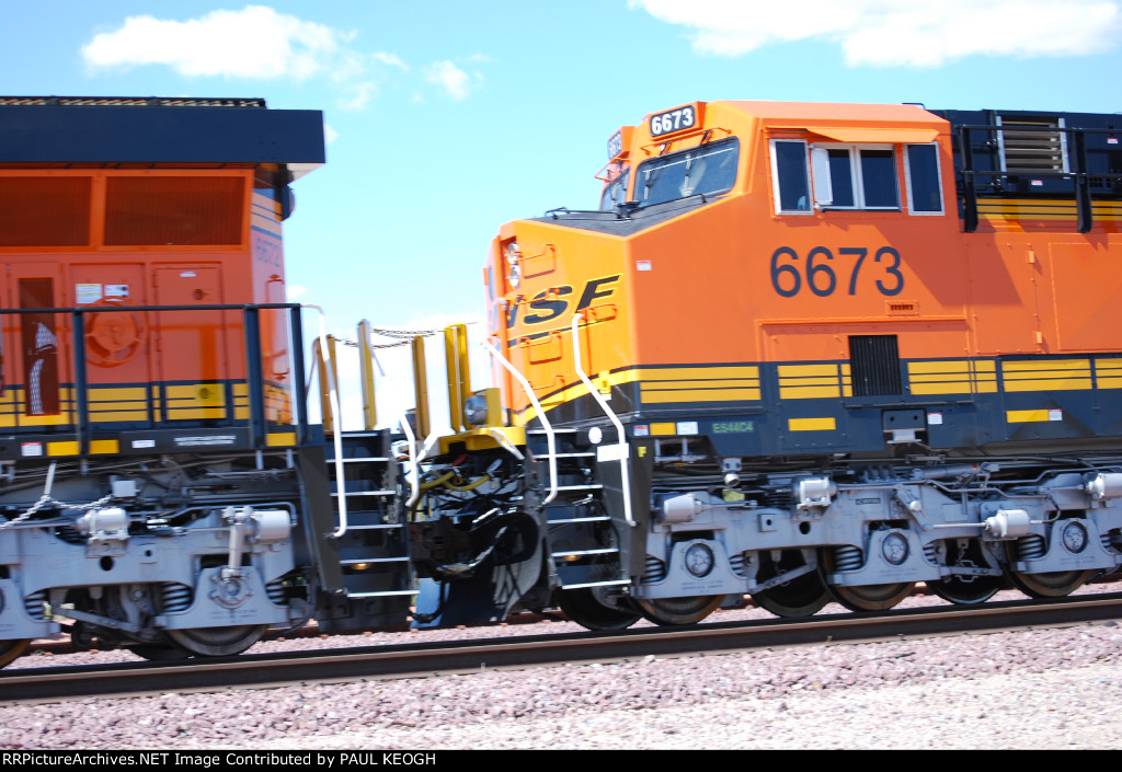 Up close shot of the rear end of BNSF 6672 and the front end cab of BNSF 6673 as they roll west pulling the Z CHI-SCO.