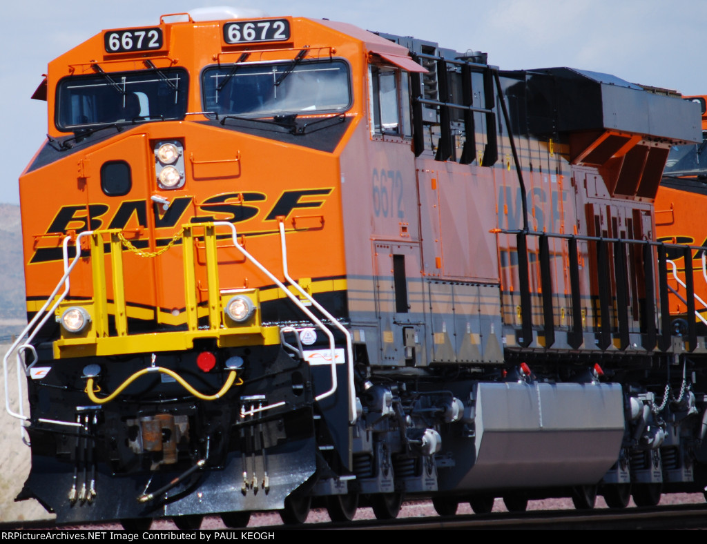 Up Close of a Very Very Brand New BNSF 6672 leading the Hot Z CHI-SCO on her First Revenue Run West.