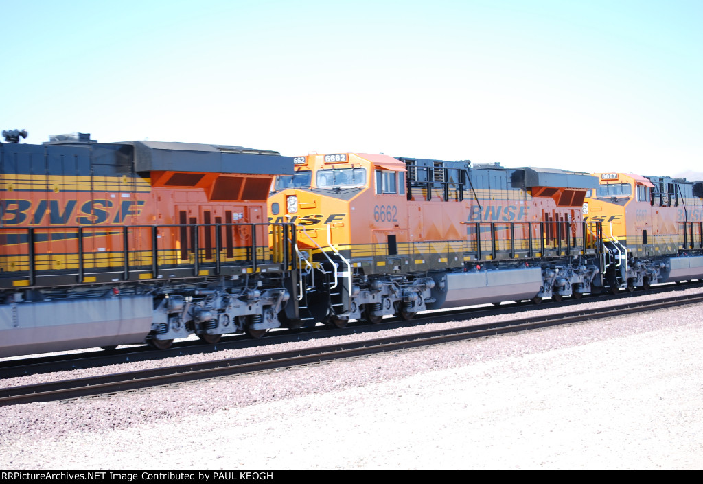 BNSF 6662 rolls west as a #2 unit behind BNSF 6661 (Lead Unit) and BNSF 6667 is the #3 unit on this westbound Z.