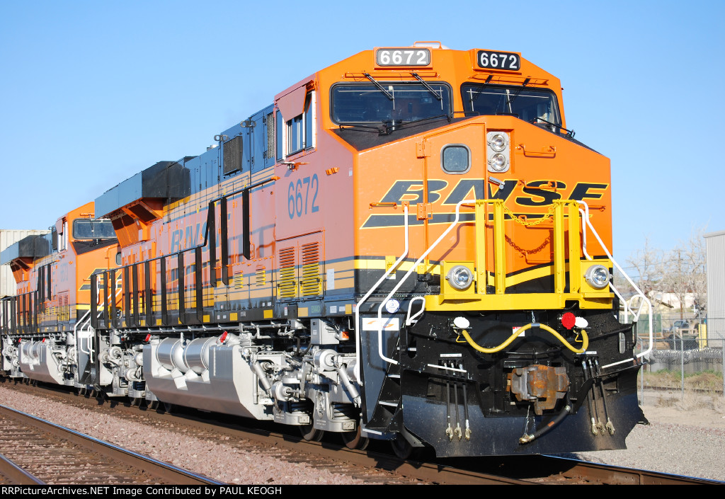 BNSF 6672 and BNSF 6673 Gleem in the Settting Sun's Rays as they wait to roll eastbound as Rear DPU's on their First Revenue Run Return Trip.