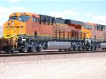 Close up of BNSF 6671 and BNSF 6670 as they push the Z CHI-SCO west out of BNSF Barstow yard,