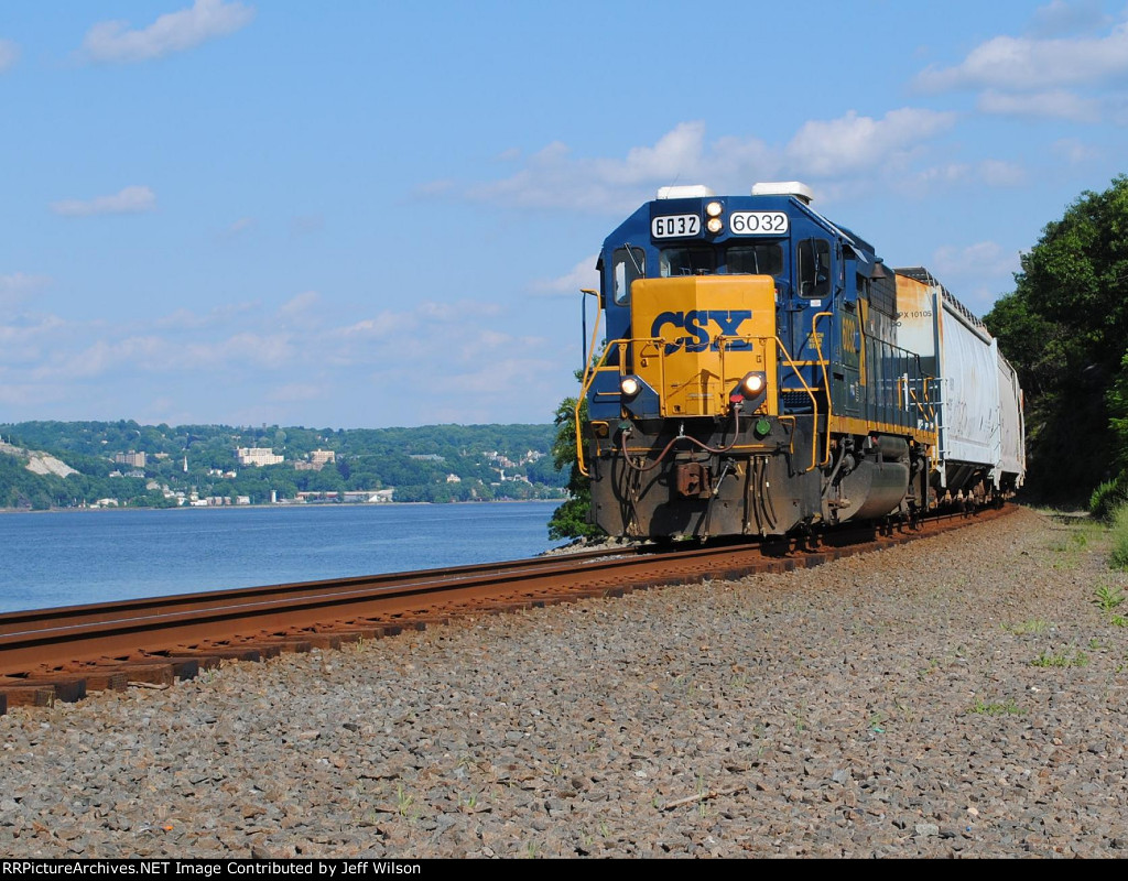 Northbound local with Peekskill in the background
