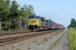 high cubes with auto parts heads west on csx