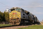 Westbound KCS Grain Passes by Agri Star