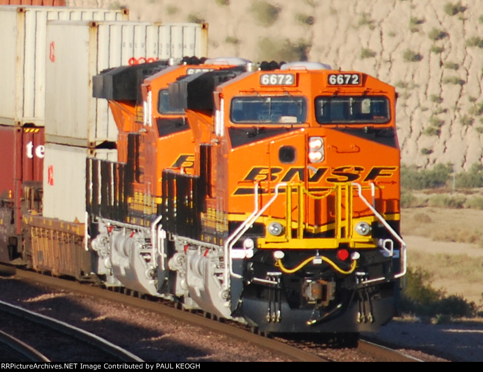 Almost in the Cab of BNSF 6672 as she and Her Sister ES44C4 BNSF 6673 push a Hot LA Z-Train eastbound as the Sun Reflects of their 6 Day Old BNSF Swoosh Logo.