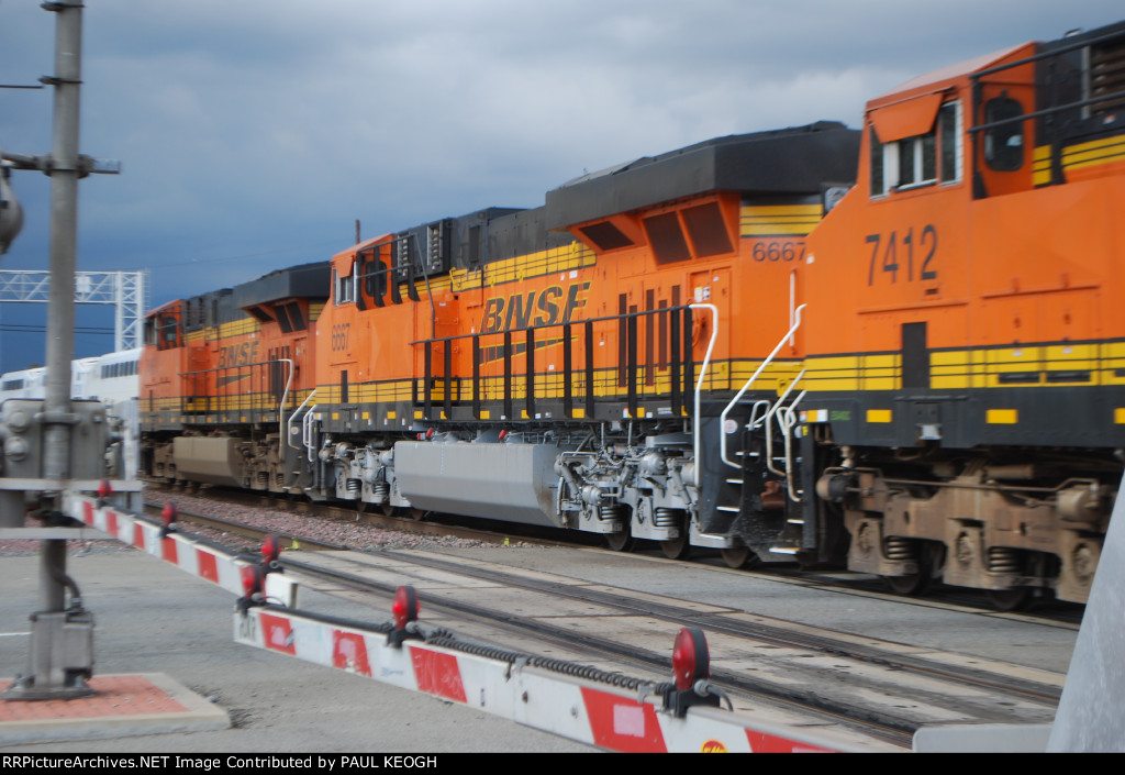 BNSF 6667 as a #2 unit on a eastbound Z-Train crosses over Valley Blvd with BNSF 7412 as the #3 unit.