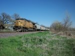 UP 6764 DPU on eastbound UP loaded grain train