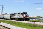 NERR 8585 leads a train by the yard