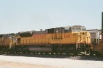 SD9043 shoving hard on the rear of a Stack train