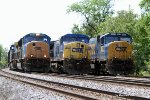 Q825-02 passes a pair of parked coal trains on #1