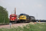 Westbound CP Freight waits in the Siding as Westbound CSX Empty Ethanol Passes by