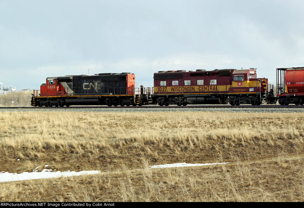 CN 5358 and WC 3027 approach Ross Junction and the Saskatchewah River bridge on CN's Vegreville Sub