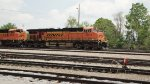 BNSF 5874 and 9353 wait for a clear signal to exit Debutts Yard.