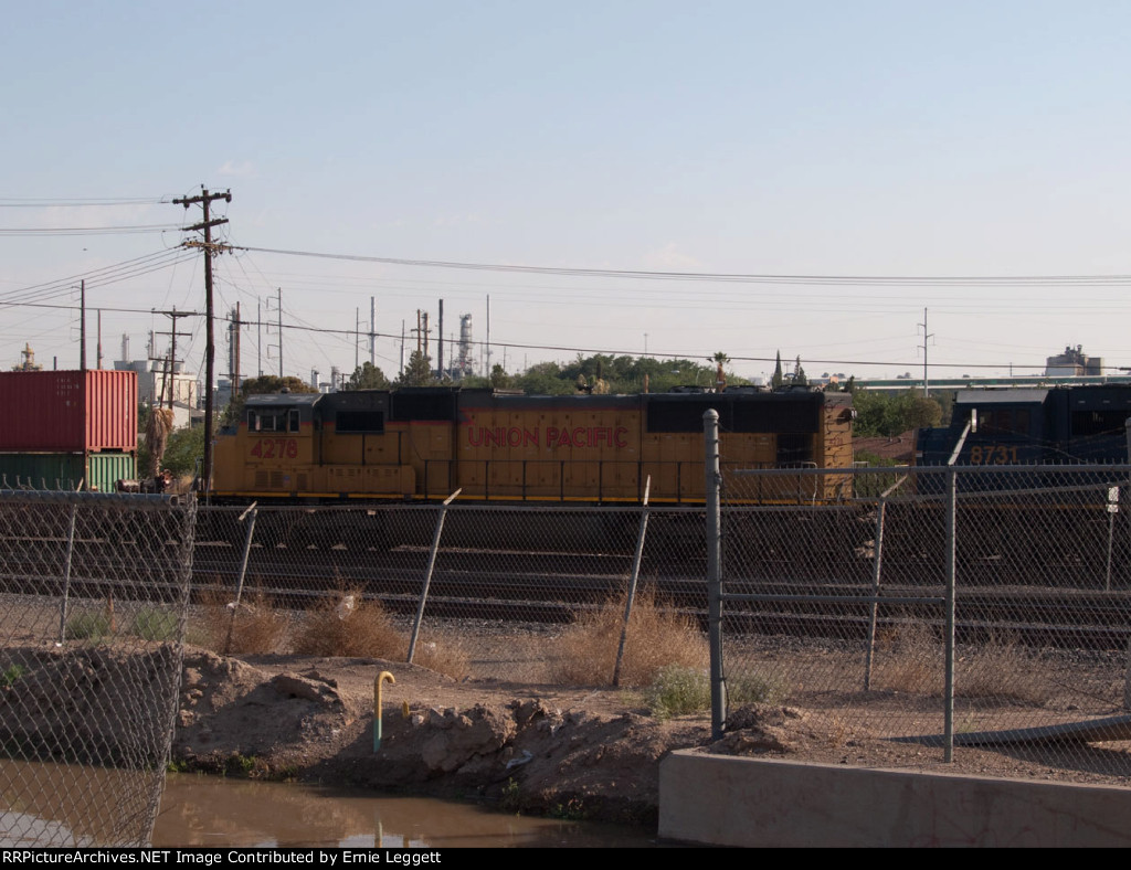 UP 4278 #4 power in an EB doublestack into Alfalfa Yard at 08:23am