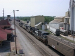 SB freight enters the yard past the depot and tower