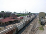 SB freight eases into the yard past the depot and the tower