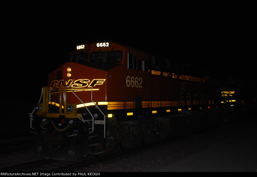 BNSF 6662 Lights Up her BNSF Swoosh Logo as her LED Road Numbers shine out as she waits head eastbound as the Rearmost DPU on the Z LAC-LPC Intermodal Train.