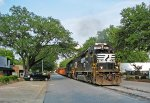 NS G91 passing down tree lined Roosevelt Avenue