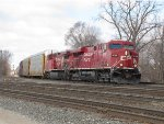 CP 8766 leans through the curve at CP437 as it leads 36T east