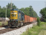 CSX 8874 sits in the siding with a W064 ballast train