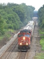 M395 rolls west away from the old Wabash bridge