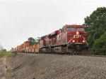 CP 8732 & 8519 roll west through a light rain with 23T