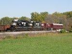 Running as 906, an NS track geometry train crosses the diamond at NE