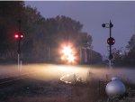 The headlights of CSX 144 pierce the fog as Q512 heads north