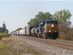 Q324 comes east out of town led by CSX 940