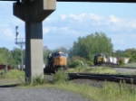 CSX 4780 on the point passing the Q404 on the NYS&W Geddes St. Lead