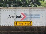 "The old Amtrak ""pointless arrow"" logo on an Amtrak bridge"