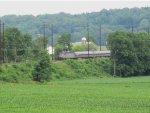 An Amtrak Keystone Corridor train moves through the Lancaster County farmlands