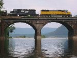 Yellow NS Loco crosses Rockville Bridge