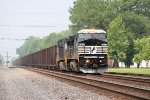Eastbou8nd Herzog stone train symbol 927 hustles into town behind an ex-Conrail C40-8W