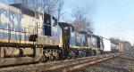 A CSX switcher third back on a mixed freight
