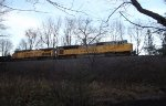 "UP Dirt train with ""We Will Deliver"" SD90 in the lead"